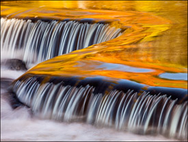 Yellow and orange reflections upstream from Bond Falls, Upper Michigan